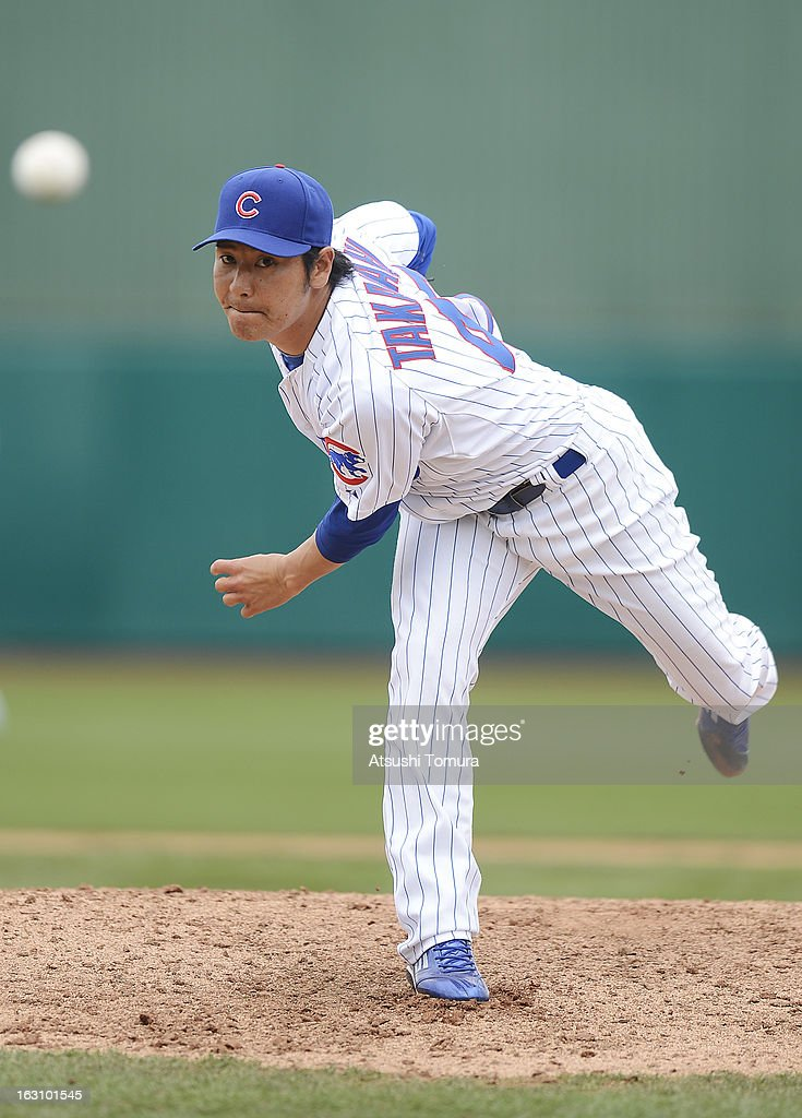 Pitcher Hisanori Takahashi #47 of Chicago Cubs throws during the spring training match against Milwaukee Brewers on March 3, 2013 in Mesa, Arizona.