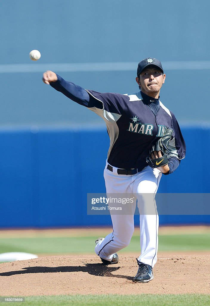 Pitcher <a gi-track='captionPersonalityLinkClicked' href=/galleries/search?phrase=Hisashi+Iwakuma&family=editorial&specificpeople=5723798 ng-click='$event.stopPropagation()'>Hisashi Iwakuma</a> #18 of Seattle Mariners throws during the spring training match against Los Angeles Dodgers on March 2, 2013 in Peoria, Arizona.
