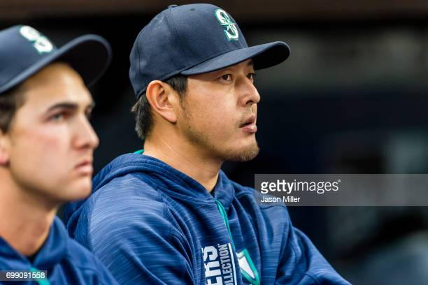 Pitcher Hisashi Iwakuma of the Seattle Mariners watches from the dugout during the first inning against the Cleveland Indians at Progressive Field on...