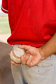 Pitcher Holding Baseball Behind His Back