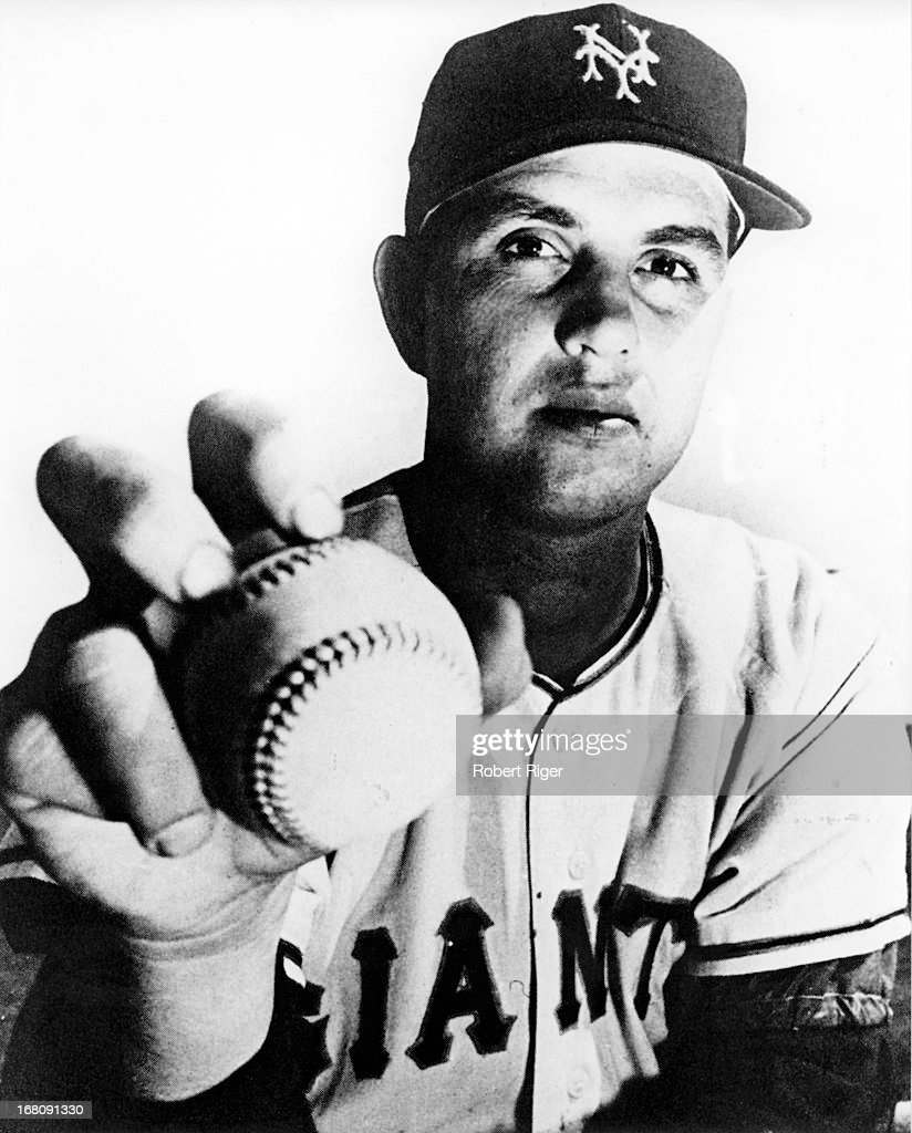 Pitcher Hoyt Wilhelm of the New York Giants shows how he holds the ball for a knuckleball while posing for a portrait circa 1952 in New York New York