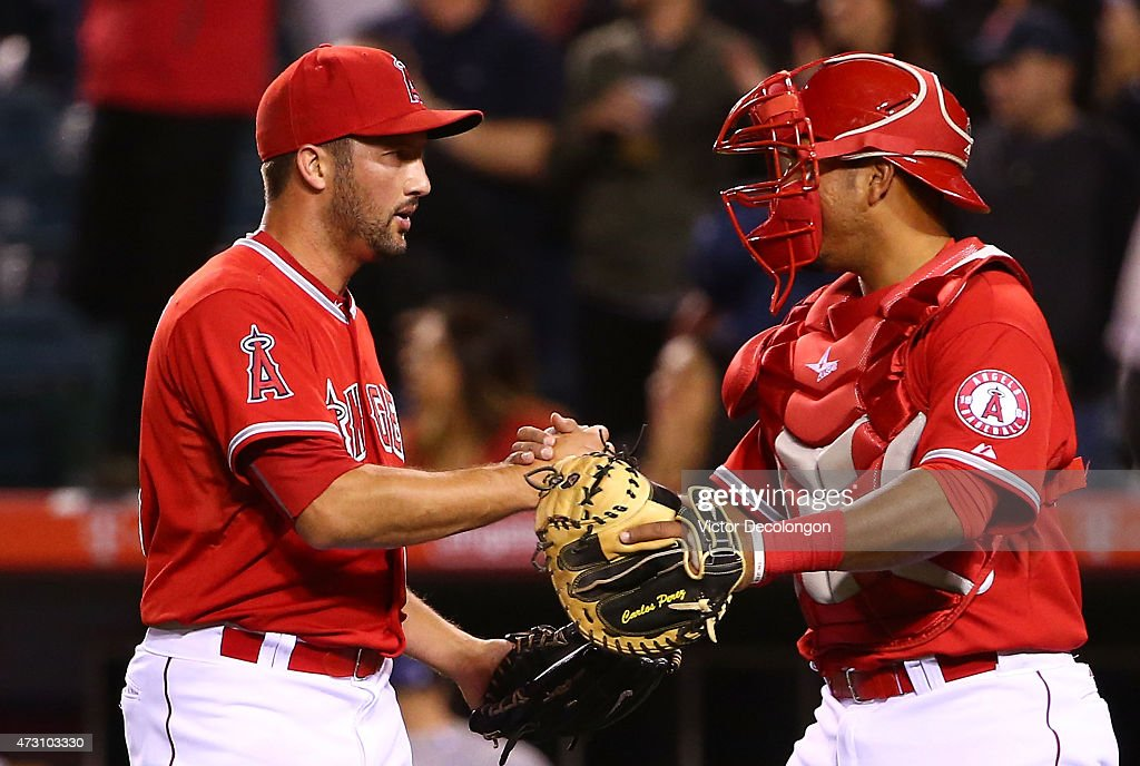 Pitcher Huston Street #16 of the Los Angeles Angels of Anaheim celebrates with catcher Carlos Perez #58 after their MLB game against the Colorado Rockies at Angel Stadium of Anaheim on May 12, 2015 in Anaheim, California. The Angels defeated the Rockies 5-2.