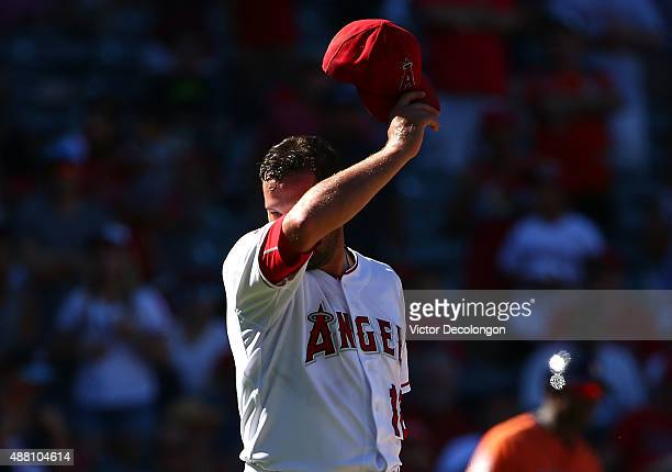 Pitcher Huston Street of the Los Angeles Angels of Anaheim wipes his face in the ninth inning during the MLB game against the Houston Astros at Angel...