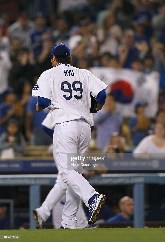 Pitcher Hyun-Jin Ryu #99 of the Los Angeles Dodgers leaves the game in the seventh inning during the MLB game against the Miami Marlins at Dodger Stadium on May 11, 2013 in Los Angeles, California. The Dodgers defeated the Marlins 7-1.