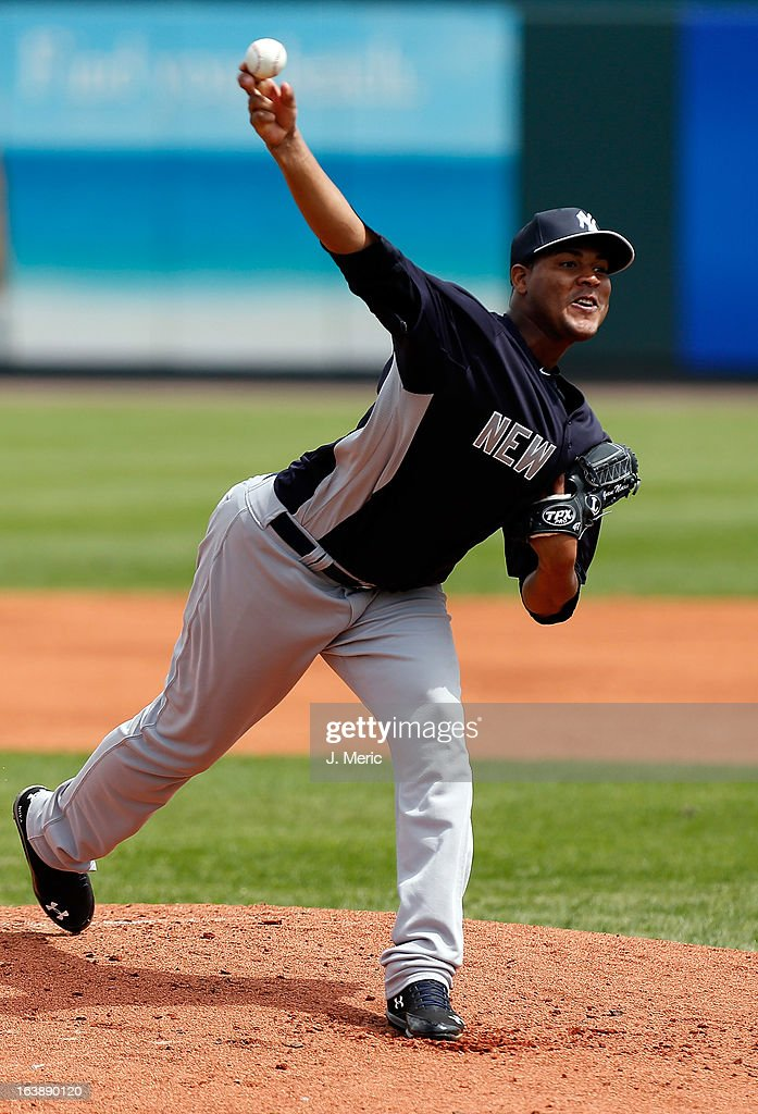 Pitcher <a gi-track='captionPersonalityLinkClicked' href=/galleries/search?phrase=Ivan+Nova&family=editorial&specificpeople=5743486 ng-click='$event.stopPropagation()'>Ivan Nova</a> #47 of the New York Yankees pitches against the Pittsburgh Pirates during a Grapefruit League Spring Training Game at McKechnie Field on March 17, 2013 in Bradenton, Florida.