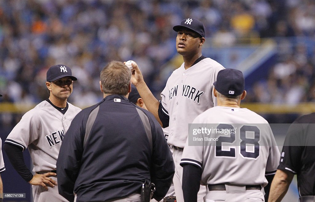 Pitcher <a gi-track='captionPersonalityLinkClicked' href=/galleries/search?phrase=Ivan+Nova&family=editorial&specificpeople=5743486 ng-click='$event.stopPropagation()'>Ivan Nova</a> #47 of the New York Yankees reacts as <a gi-track='captionPersonalityLinkClicked' href=/galleries/search?phrase=Joe+Girardi&family=editorial&specificpeople=208659 ng-click='$event.stopPropagation()'>Joe Girardi</a> #28 of the New York Yankees comes out to take him off the mound during the game against the Tampa Bay Rays on April 19, 2014 at Tropicana Field in St. Petersburg, Florida.