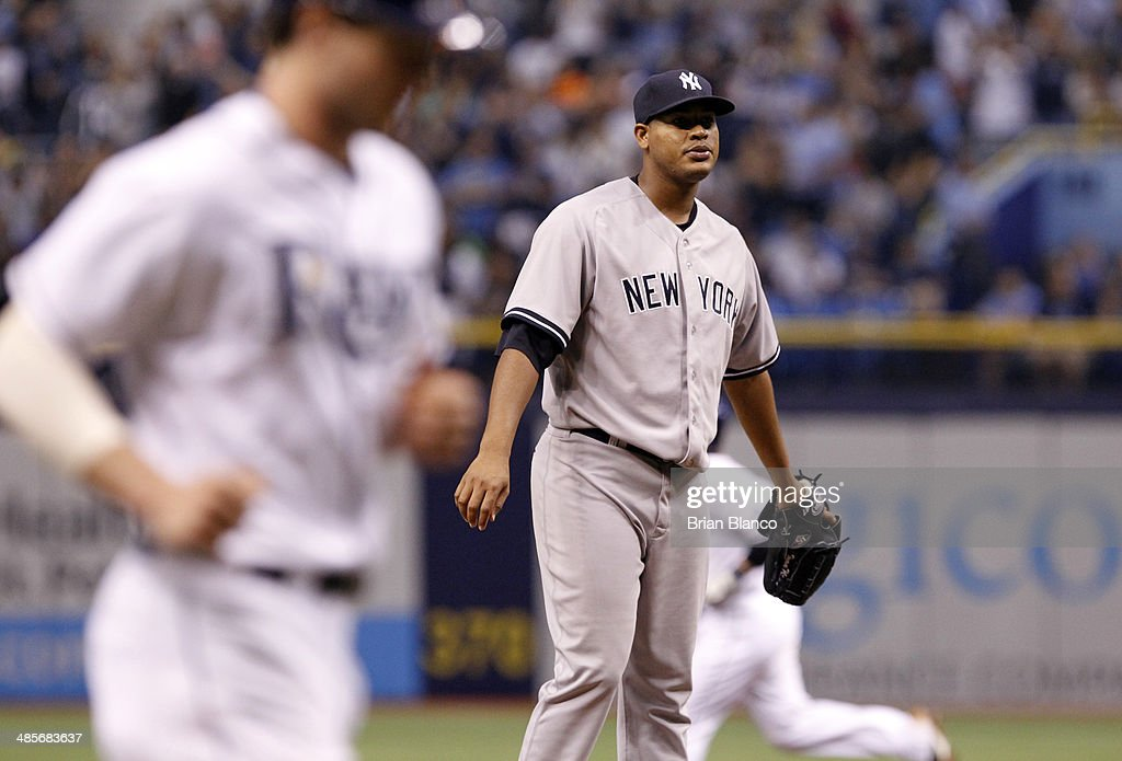 Pitcher Ivan Nova (C) of the New York Yankees reacts on the mound as Wil Myers (L) of the Tampa Bay Rays and Ryan Hanigan (R) of the Tampa Bay Rays round the bases to score off of Hanigan's two-run home run during the fourth inning of a game on April 19, 2014 at Tropicana Field in St. Petersburg, Florida.