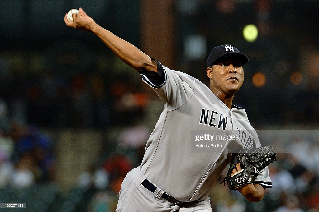 Pitcher <a gi-track='captionPersonalityLinkClicked' href=/galleries/search?phrase=Ivan+Nova&family=editorial&specificpeople=5743486 ng-click='$event.stopPropagation()'>Ivan Nova</a> #47 of the New York Yankees works the first inning against the Baltimore Orioles at Oriole Park at Camden Yards on September 10, 2013 in Baltimore, Maryland.