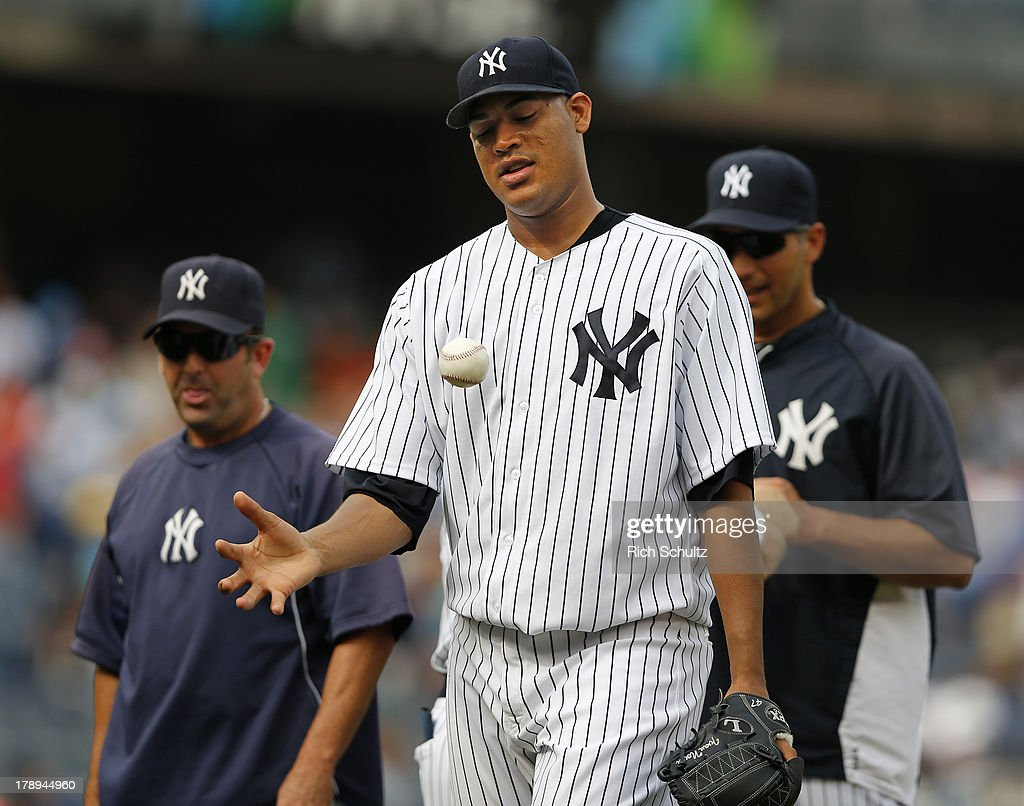 Pitcher <a gi-track='captionPersonalityLinkClicked' href=/galleries/search?phrase=Ivan+Nova&family=editorial&specificpeople=5743486 ng-click='$event.stopPropagation()'>Ivan Nova</a> #47 walks off the field after throwing a complete game, three hit shutout against the Baltimore Orioles in a MLB baseball game at Yankee Stadium on August 31, 2013 in the Bronx borough of New York City. The Yankees defeated the Orioles 2-0.