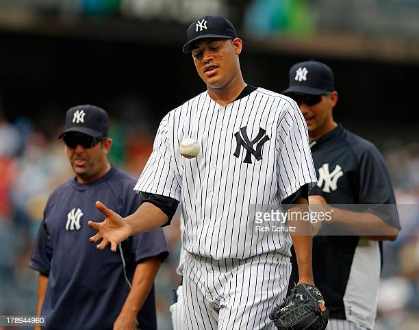 Pitcher Ivan Nova walks off the field after throwing a complete game three hit shutout against the Baltimore Orioles in a MLB baseball game at Yankee...