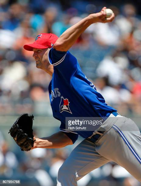 Pitcher JA Happ of the Toronto Blue Jays delivers a pitch against the New York Yankees during the first inning of a game at Yankee Stadium on July 4...