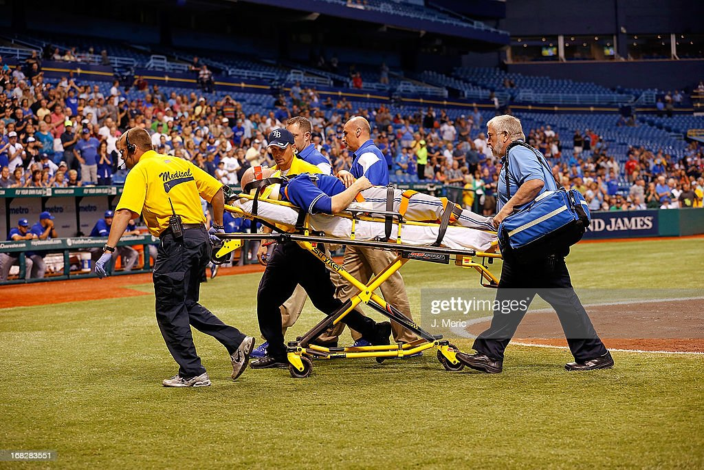 Pitcher J.A. Happ #48 of the Toronto Blue Jays is taken off the field after he was hit by a line drive from the Tampa Bay Rays during the game at Tropicana Field on May 7, 2013 in St. Petersburg, Florida.