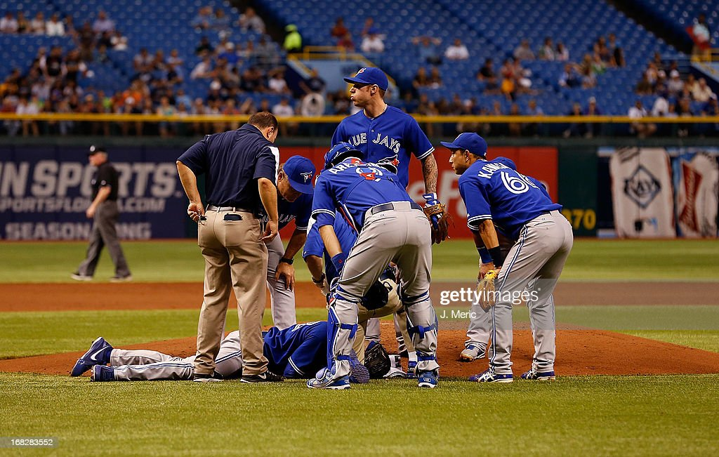 Pitcher J.A. Happ #48 of the Toronto Blue Jays lies on the mound after he was hit by a line drive from the Tampa Bay Rays during the game at Tropicana Field on May 7, 2013 in St. Petersburg, Florida.