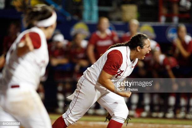 Pitcher Jackie Traina of the University of Alabama celebrates the final out against the University of Oklahoma during the Division I Women's Softball...