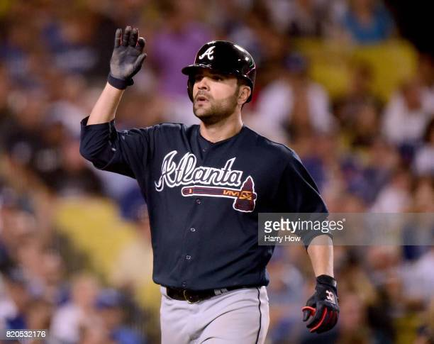 Pitcher Jaime Garcia of the Atlanta Braves celebrates his grand slam homerun to take a 90 lead during the fifth inning at Dodger Stadium on July 21...