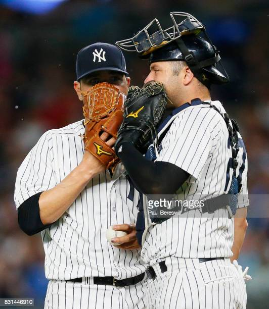 Pitcher Jaime Garcia of the New York Yankees talks with catcher Austin Romine of the New York Yankees on the mound in an MLB baseball game against...