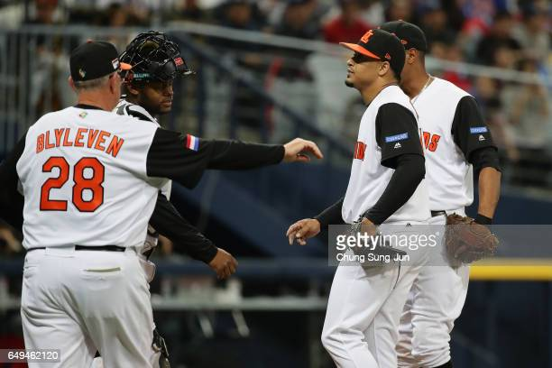 Pitcher Jair Jurrjens and infielders of the Netherlands gather on the mound in the top of the second inning during the World Baseball Classic Pool A...