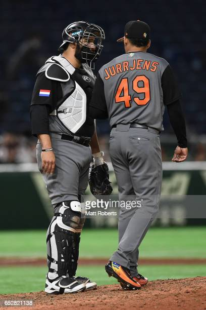 Pitcher Jair Jurrjens of the Netherlands and Catcher Shawn Zarraga talk on the mound in the bottom of the sixth inning during the World Baseball...