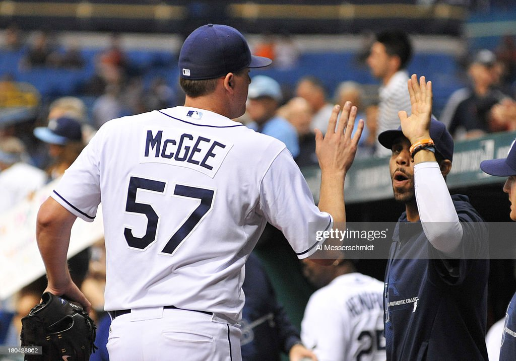 Pitcher Jake McGee #57 of the Tampa Bay Rays celebrates with pitcher David Price #14 after throwing in relief against the Boston Red Sox September 12, 2013 at Tropicana Field in St. Petersburg, Florida.