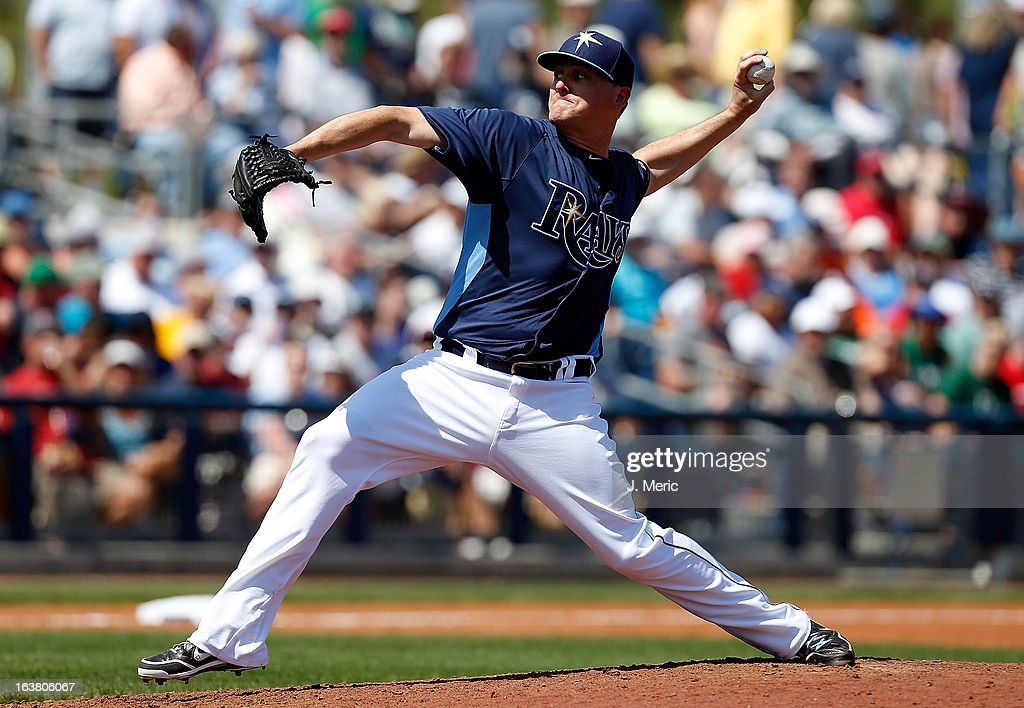 Pitcher <a gi-track='captionPersonalityLinkClicked' href=/galleries/search?phrase=Jake+McGee+-+Joueur+de+baseball&family=editorial&specificpeople=15096866 ng-click='$event.stopPropagation()'>Jake McGee</a> #57 of the Tampa Bay Rays pitches against the Boston Red Sox during a Grapefruit League Spring Training Game at the Charlotte Sports Complex on March 16, 2013 in Port Charlotte, Florida.