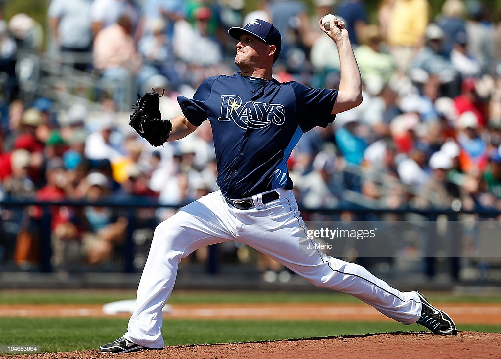 Pitcher Jake McGee #57 of the Tampa Bay Rays pitches against the Boston Red Sox during a Grapefruit League Spring Training Game at the Charlotte Sports Complex on March 16, 2013 in Port Charlotte, Florida.