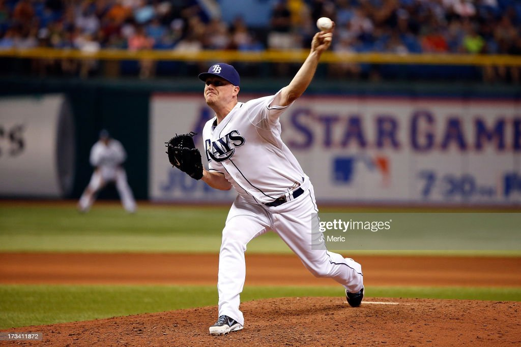 Pitcher <a gi-track='captionPersonalityLinkClicked' href=/galleries/search?phrase=Jake+McGee+-+Baseball+Player&family=editorial&specificpeople=15096866 ng-click='$event.stopPropagation()'>Jake McGee</a> #57 of the Tampa Bay Rays pitches against the Houston Astros during the game at Tropicana Field on July 13, 2013 in St. Petersburg, Florida.