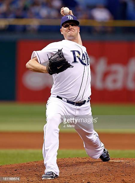 Pitcher Jake McGee of the Tampa Bay Rays pitches against the Oakland Athletics during the game at Tropicana Field on August 24 2012 in St Petersburg...