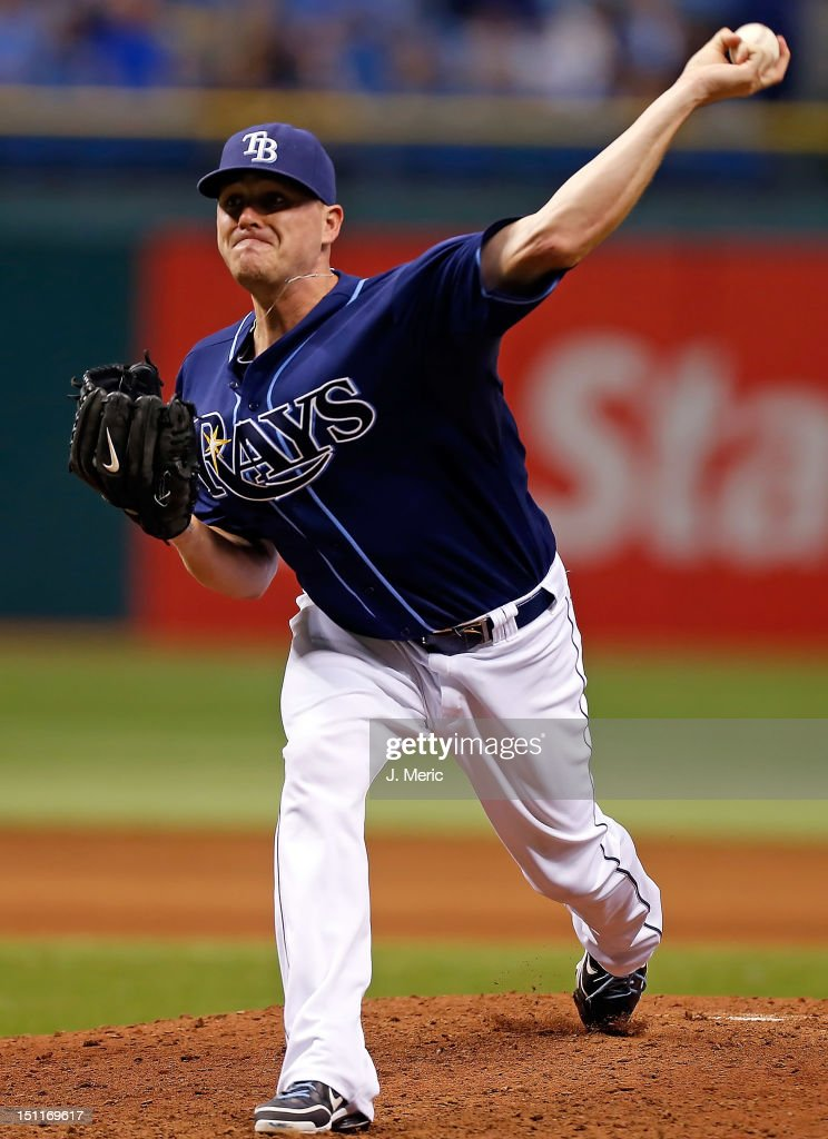 Pitcher <a gi-track='captionPersonalityLinkClicked' href=/galleries/search?phrase=Jake+McGee+-+Baseball+Player&family=editorial&specificpeople=15096866 ng-click='$event.stopPropagation()'>Jake McGee</a> #57 of the Tampa Bay Rays pitches against the Oakland Athletics during the game at Tropicana Field on August 25, 2012 in St. Petersburg, Florida.