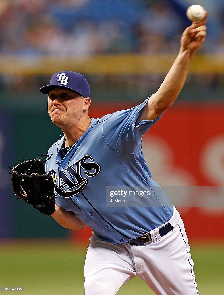 Pitcher <a gi-track='captionPersonalityLinkClicked' href=/galleries/search?phrase=Jake+McGee+-+Baseball+Player&family=editorial&specificpeople=15096866 ng-click='$event.stopPropagation()'>Jake McGee</a> #57 of the Tampa Bay Rays pitches against the Oakland Athletics during the game at Tropicana Field on April 21, 2013 in St. Petersburg, Florida.