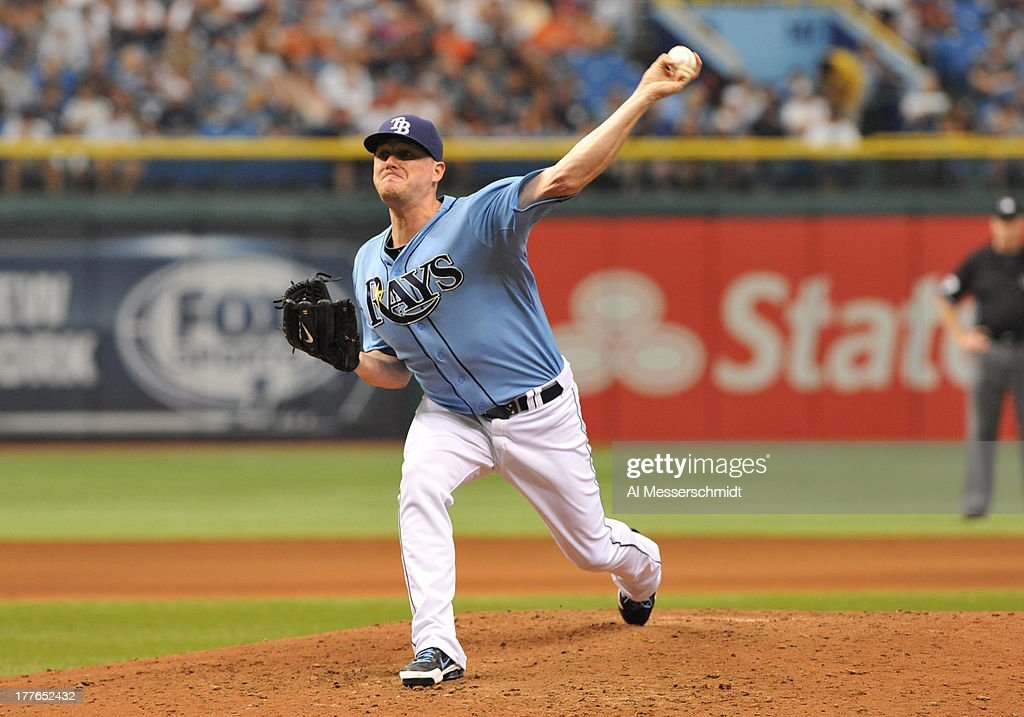 Pitcher <a gi-track='captionPersonalityLinkClicked' href=/galleries/search?phrase=Jake+McGee+-+Baseball+Player&family=editorial&specificpeople=15096866 ng-click='$event.stopPropagation()'>Jake McGee</a> #57 of the Tampa Bay Rays throws in relief against the New York Yankees August 25, 2013 at Tropicana Field in St. Petersburg, Florida. The Yankees won 3 - 2 in 11 innings.