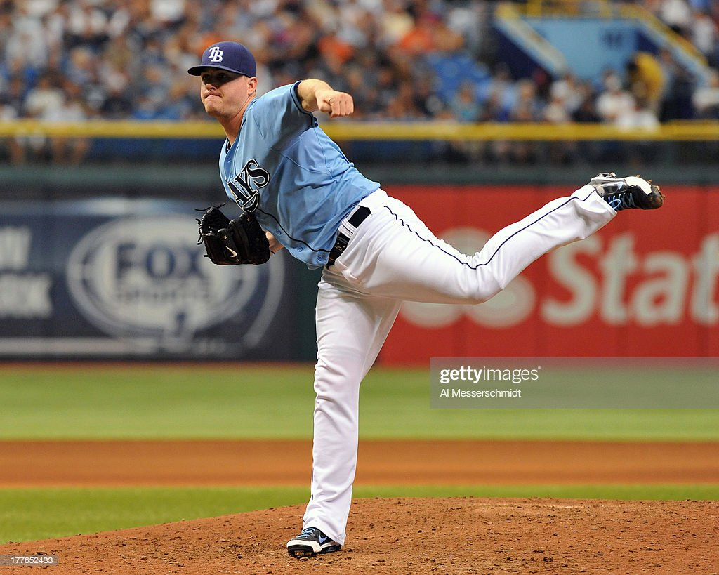 Pitcher Jake McGee #57 of the Tampa Bay Rays throws in relief against the New York Yankees August 25, 2013 at Tropicana Field in St. Petersburg, Florida. The Yankees won 3 - 2 in 11 innings.