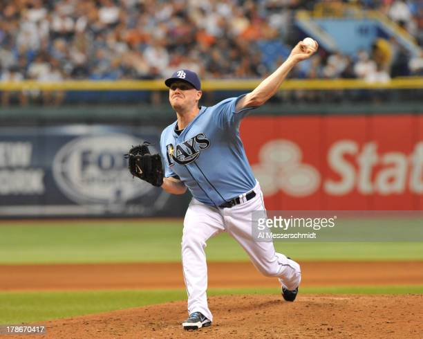 Pitcher Jake McGee of the Tampa Bay Rays throws in relief against the New York Yankees August 25 2013 at Tropicana Field in St Petersburg Florida The...
