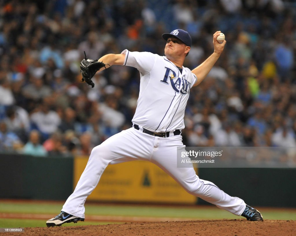 Pitcher <a gi-track='captionPersonalityLinkClicked' href=/galleries/search?phrase=Jake+McGee+-+Baseball+Player&family=editorial&specificpeople=15096866 ng-click='$event.stopPropagation()'>Jake McGee</a> #57 of the Tampa Bay Rays throws in relief against the Baltimore Orioles September 20, 2013 at Tropicana Field in St. Petersburg, Florida.
