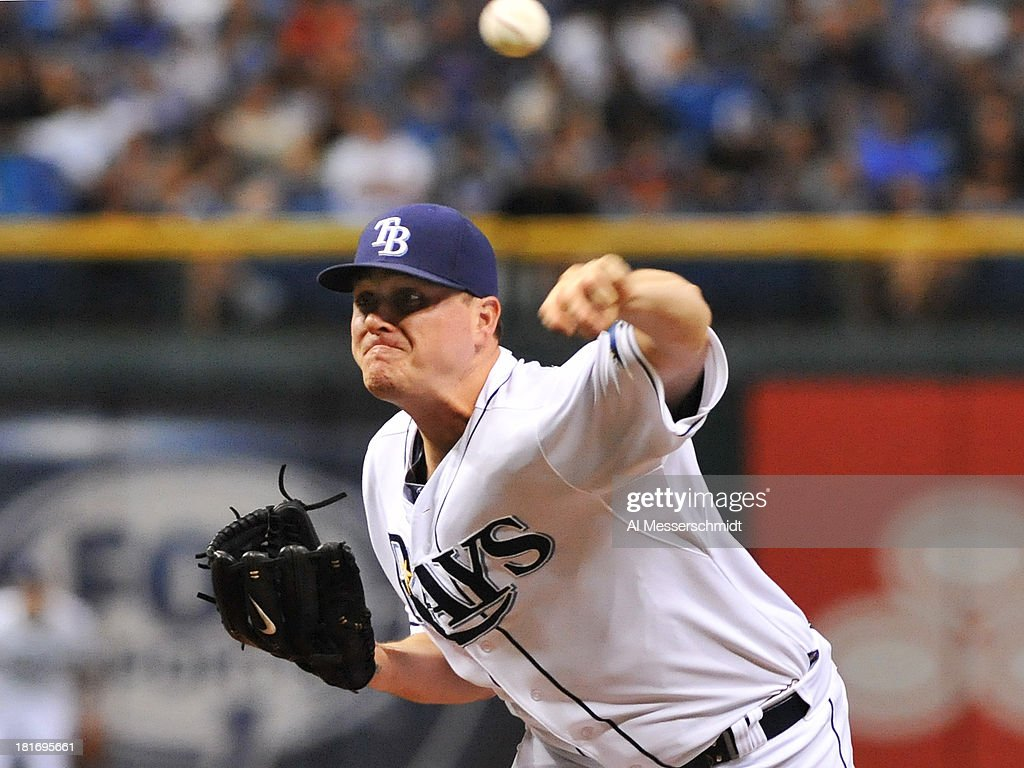 Pitcher Jake McGee #57 of the Tampa Bay Rays throws in relief against the Baltimore Orioles September 23, 2013 at Tropicana Field in St. Petersburg, Florida.