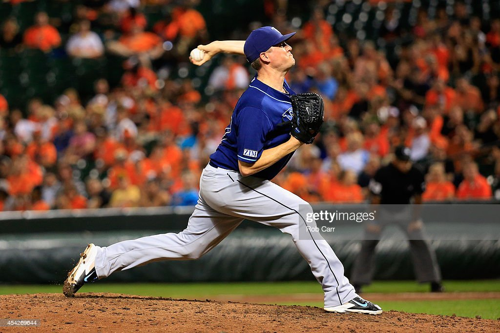 Pitcher Jake McGee #57 of the Tampa Bay Rays throws to a Baltimore Orioles batter during the ninth inning of the Rays 3-1 win at Oriole Park at Camden Yards on August 27, 2014 in Baltimore, Maryland.