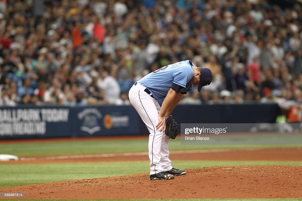 Pitcher <a gi-track='captionPersonalityLinkClicked' href=/galleries/search?phrase=Jake+Odorizzi&family=editorial&specificpeople=9013227 ng-click='$event.stopPropagation()'>Jake Odorizzi</a> #23 of the Tampa Bay Rays reacts on the mound after giving up a two-run single to Starlin Castro of the New York Yankees during the seventh inning of a game on May 29, 2016 at Tropicana Field in St. Petersburg, Florida.