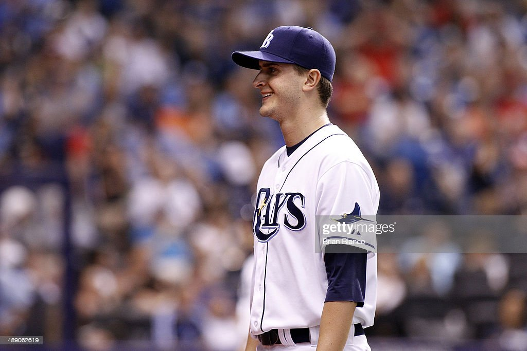 Pitcher <a gi-track='captionPersonalityLinkClicked' href=/galleries/search?phrase=Jake+Odorizzi&family=editorial&specificpeople=9013227 ng-click='$event.stopPropagation()'>Jake Odorizzi</a> #23 of the Tampa Bay Rays smiles as he walks back to the dugout following his 11th strike out to end the top of the fifth inning of a game against the Cleveland Indians on May 9, 2014 at Tropicana Field in St. Petersburg, Florida.