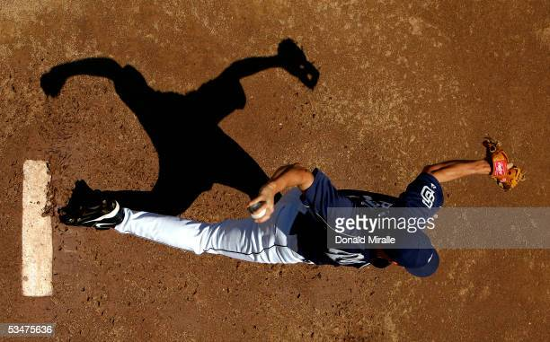 Pitcher Jake Peavy of the San Diego Padres throws from the mound in the bullpen before the start of their game against the Colorado Rockies August 28...