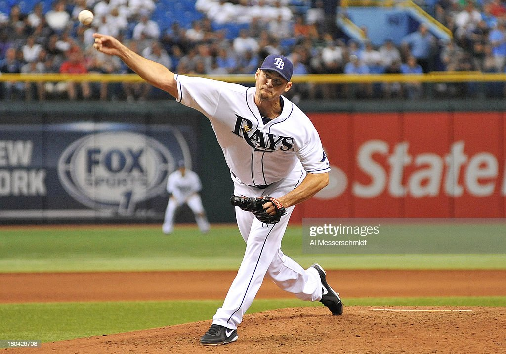 Pitcher <a gi-track='captionPersonalityLinkClicked' href=/galleries/search?phrase=Jamey+Wright&family=editorial&specificpeople=220683 ng-click='$event.stopPropagation()'>Jamey Wright</a> #35 of the Tampa Bay Rays throws in relief against the Boston Red Sox September 12, 2013 at Tropicana Field in St. Petersburg, Florida.