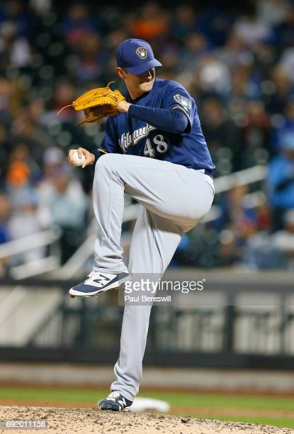 Pitcher Jared Hughes of the Milwaukee Brewers throws a pitch in an MLB baseball game against the New York Mets on May 31 2017 at CitiField in the...