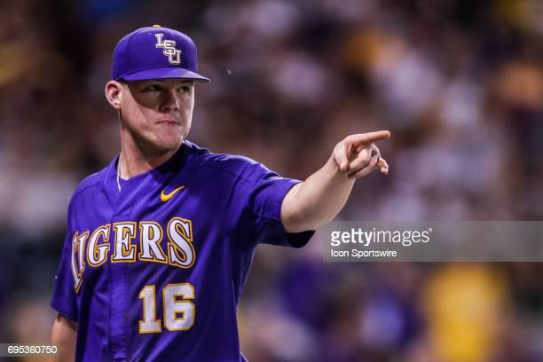 LSU pitcher Jared Poche' points to infielder Kramer Robertson as he ends the inning during the Baton Rouge Division I Super Regional game between...