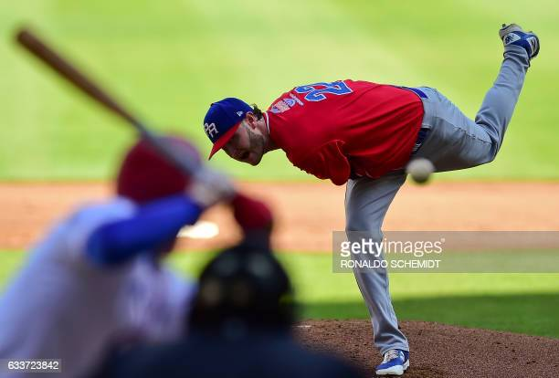 TOPSHOT Pitcher Jarret Leverett of Criollos de Caguas from Puerto Rico throws the ball in a match against Cuba's Alazanes de Granma during the...