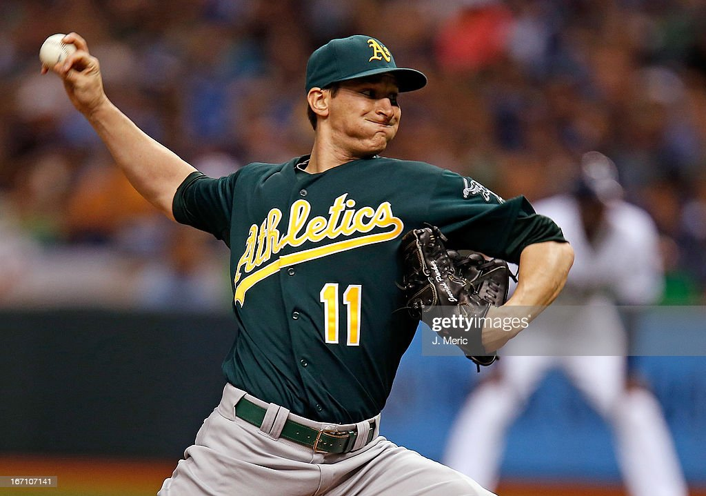 Pitcher <a gi-track='captionPersonalityLinkClicked' href=/galleries/search?phrase=Jarrod+Parker&family=editorial&specificpeople=5970942 ng-click='$event.stopPropagation()'>Jarrod Parker</a> #11 of the Oakland Athletics pitches against the Tampa Bay Rays during the game at Tropicana Field on April 20, 2013 in St. Petersburg, Florida.