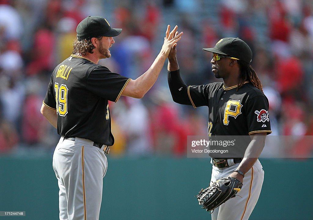 Pitcher Jason Grilli #39 of the Pittsburgh Pirates celebrates with teammate Andrew McCutchen #22 after the Pittsburgh Pirates defeated the Los Angeles Angels of Anaheim 10-9 in ten inning in their MLB game at Angel Stadium of Anaheim on June 23, 2013 in Anaheim, California.