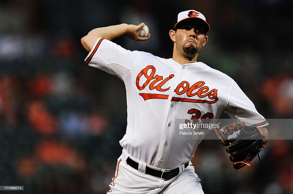 Pitcher Jason Hammel #39 of the Baltimore Orioles works the first inning against the Cleveland Indians at Oriole Park at Camden Yards on June 26, 2013 in Baltimore, Maryland.
