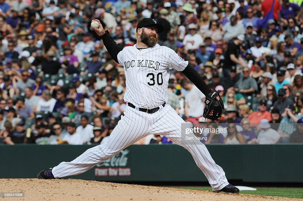 Pitcher Jason Motte of the Colorado Rockies delivers against the San Francisco Giants at Coors Field on May 29 2016 in Denver Colorado The Giants...