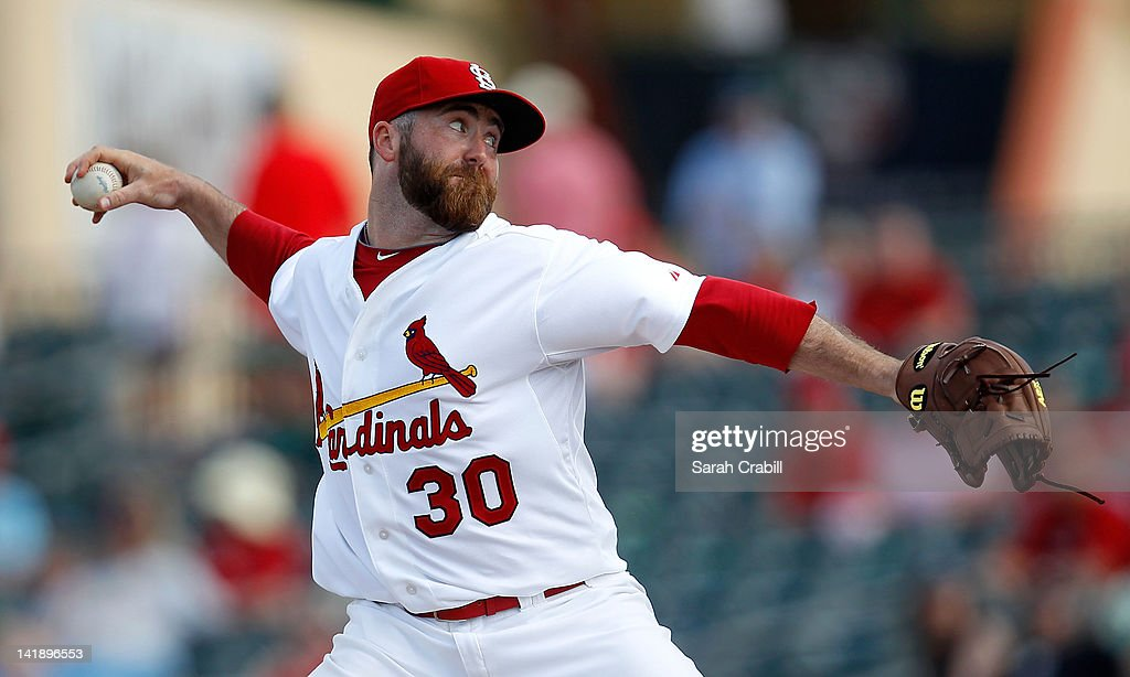 Pitcher <a gi-track='captionPersonalityLinkClicked' href=/galleries/search?phrase=Jason+Motte&family=editorial&specificpeople=803364 ng-click='$event.stopPropagation()'>Jason Motte</a> #30 of the St. Louis Cardinals pitches during a game against the Minnesota Twins at Roger Dean Stadium on March 25, 2012 in Jupiter, Florida. The St. Louis Cardinals defeated the Minnesota Twins 9-2.