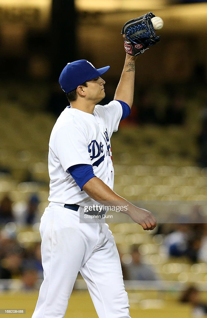Pitcher <a gi-track='captionPersonalityLinkClicked' href=/galleries/search?phrase=Javy+Guerra&family=editorial&specificpeople=6779283 ng-click='$event.stopPropagation()'>Javy Guerra</a> #48 of the Los Angeles Dodgers catches a throw from the field after giving up a run in the ninth inning against the Arizona Diamondbacks at Dodger Stadium on May 6, 2013 in Los Angeles, California.
