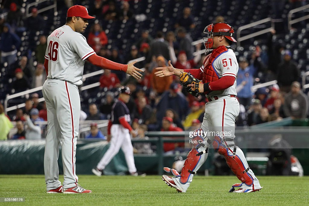 Pitcher Jeanmar Gomez and catcher Carlos Ruiz of the Philadelphia Phillies shake hands following the Phillies 30 win over the Washington Nationals at...