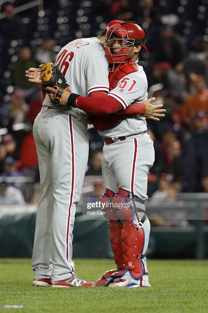 Pitcher <a gi-track='captionPersonalityLinkClicked' href=/galleries/search?phrase=Jeanmar+Gomez&family=editorial&specificpeople=6796452 ng-click='$event.stopPropagation()'>Jeanmar Gomez</a> #46 and catcher <a gi-track='captionPersonalityLinkClicked' href=/galleries/search?phrase=Carlos+Ruiz+-+Baseball+Player&family=editorial&specificpeople=216605 ng-click='$event.stopPropagation()'>Carlos Ruiz</a> #51 of the Philadelphia Phillies hug following the Phillies 3-0 win over the Washington Nationals at Nationals Park on April 27, 2016 in Washington, DC.